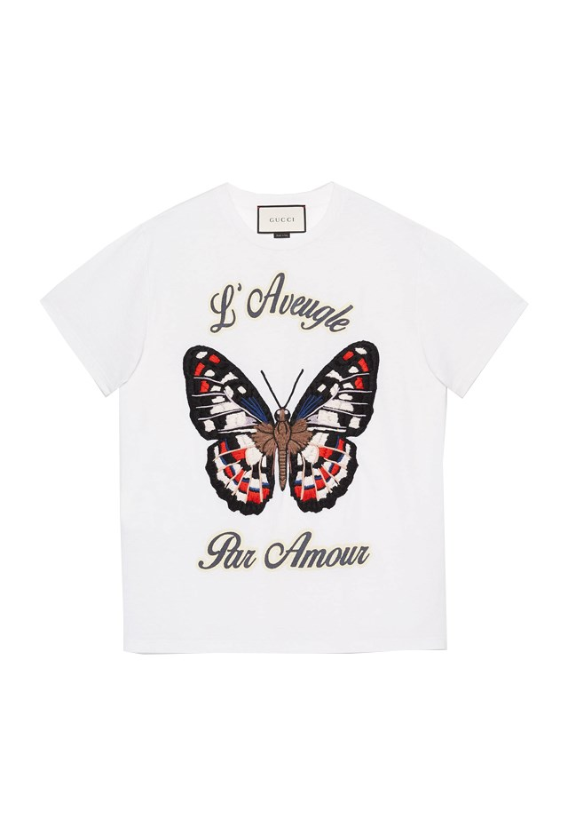 "T-Shirt, approx. $1,161, <a href=""https://www.gucci.com/us/en/pr/women/womens-ready-to-wear/womens-sweatshirts-t-shirts/butterfly-embroidered-cotton-t-shirt-p-422731X5E589230?position=12&listName=ProductGridComponent&categoryPath=Women/Womens-Ready-to-Wear/Womens-Sweatshirts-T-shirts"">Gucci</a>."