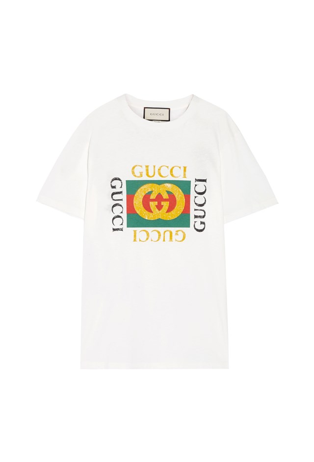 "T-Shirt, $1,010, <a href=""https://www.net-a-porter.com/au/en/product/803189/Gucci/appliqued-distressed-printed-cotton-jersey-t-shirt"">Gucci at net-a-porter.com</a>."