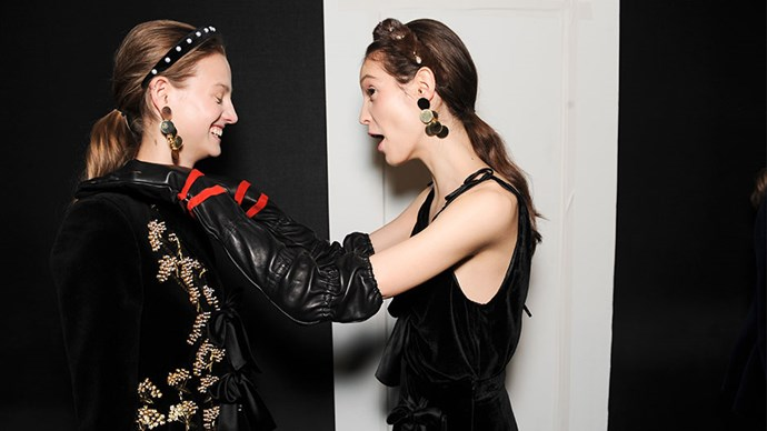 <strong>Altuzarra</strong> <br><br> Altuzarra channelled the Renaissance period. Hair was teased at the crown using a brush to give the hair lift. Then, headbands were secured two inches from the forehead.