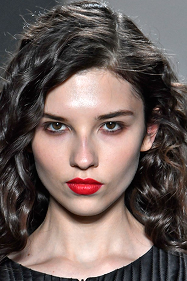<strong>Zero + Maria Cornejo</strong> <br> <br> It's rare to see a tight curl on the runway nowadays, making these glossy spirals a welcome change. Teamed with a loud red lip and a smoked-out eye, this is the perfect after work uniform.