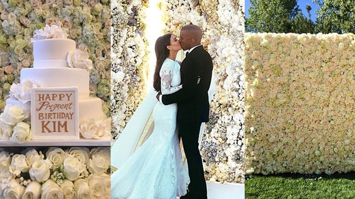 What is the truth behind 'Ye and his gifting obsession with gargantuan installations of floral arrangements? We investigate.