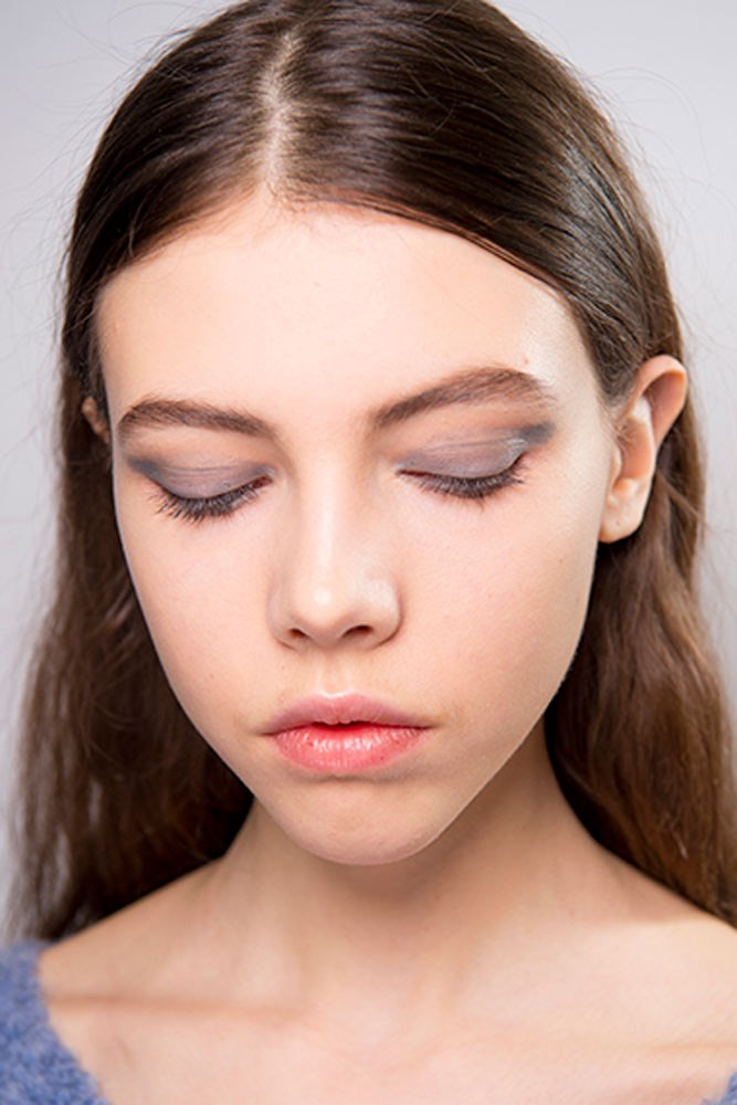 """<strong>Victoria Beckham</strong><br><br> The dreamy silver-blue hue seen on models' eyelids at Victoria Beckham is a yet-to-be-released shade from the Estee Lauder x Victoria Beckham collaboration. In the meantime, try mixing the blue and silver shades from the brand's <a href=""""https://www.esteelauder.com.au/product/631/31435/Product-Catalog/Makeup/Pure-Color-Envy/Sculpting-EyeShadow-5-Color-Palette"""">Pure Color Envy Sculpting Eyeshadow 5-Color Palette</a>."""