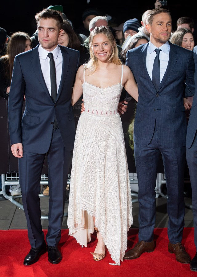Sienna Miller wore this Alexander McQueen embroidered knit dress with a handkerchief hem to the London premiere.