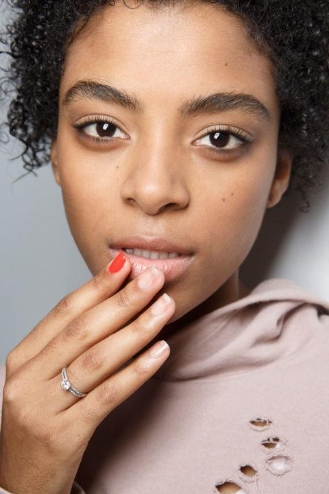 <strong>Tibi</strong> <br><br> The look: The ultimate low-maintenance nail look: When there's no time for a full paint job, hit the pointer finger with a pop of red.