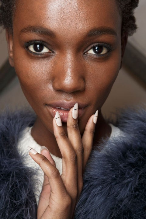<strong>Cushnie Et Ochs</strong> <br><br> The look: Nail pro Alicia Torello gives pale oval nails a refresh with linear embellishment.