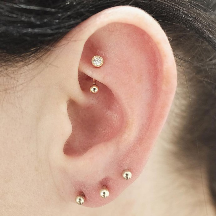 "<p><strong>Rook</strong> <p>[Rook piercings](https://www.elle.com.au/beauty/rook-piercing-20334|target=""_blank"") go through the cartilage on the ridge between the inner and outer conch. <p>Healing time: 6-10 months. <p>Image: <a href=""https://www.instagram.com/p/BMqkL1FhpVD/?taken-by=bentauber"">@bentauber</a>"