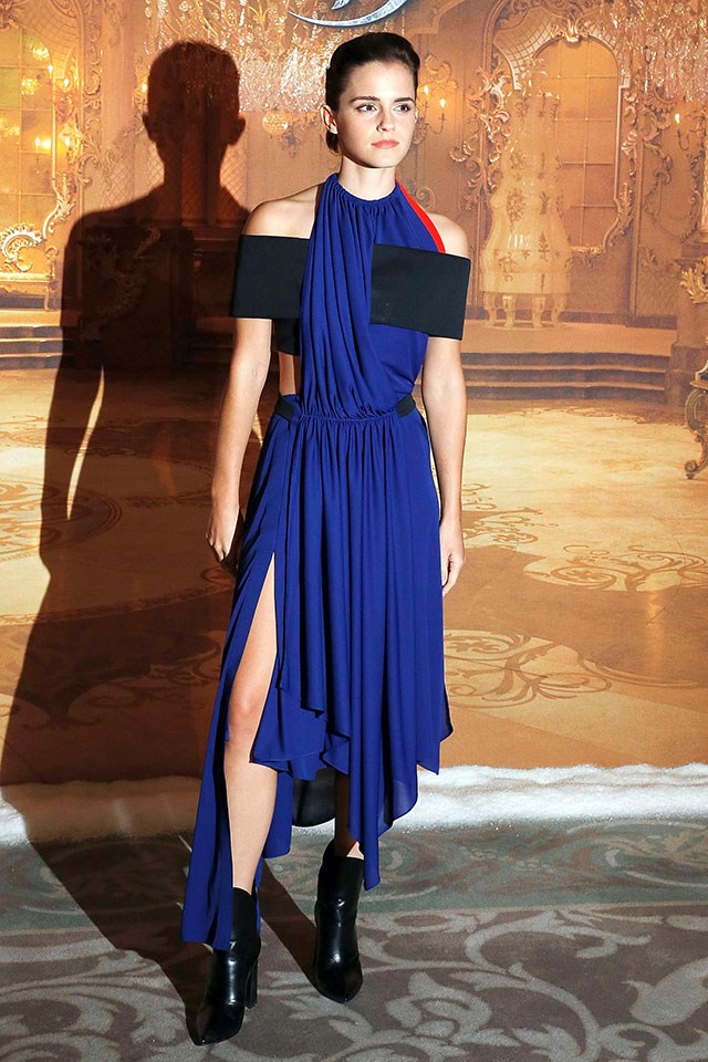 Emma wore this royal blue custom Louis Vuitton dress, with wide black straps and red detailing, to a photo call in Paris.