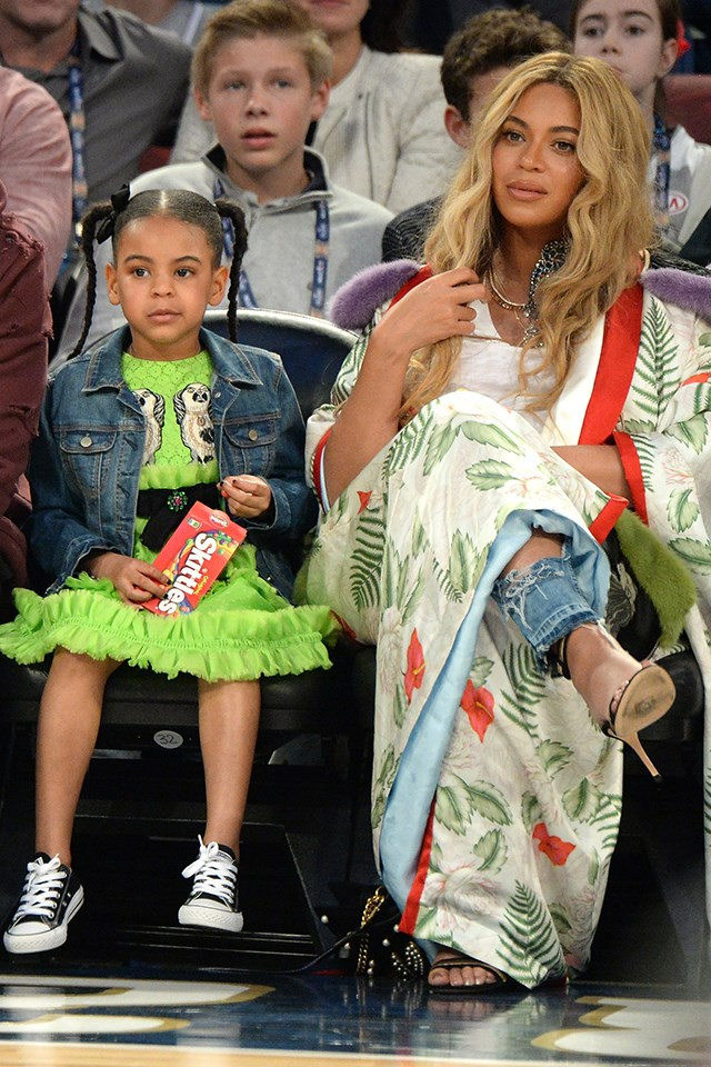"Honestly, if your mega-star mother is going to attempt to upstage you at an NBA game by being pregnant, then we think it's fair share to throw in a <a href=""https://www.gucci.com/us/en/pr/children/girls/girls-clothing-4-12-years/girls-dresses/childrens-broderie-anglaise-dress-p-455608ZB9493510"">$2,300 Gucci dress</a>. Which is exactly what Blue Ivy Carter did. Beyoncé, in true Mummy-and-me style, was also wearing Gucci."