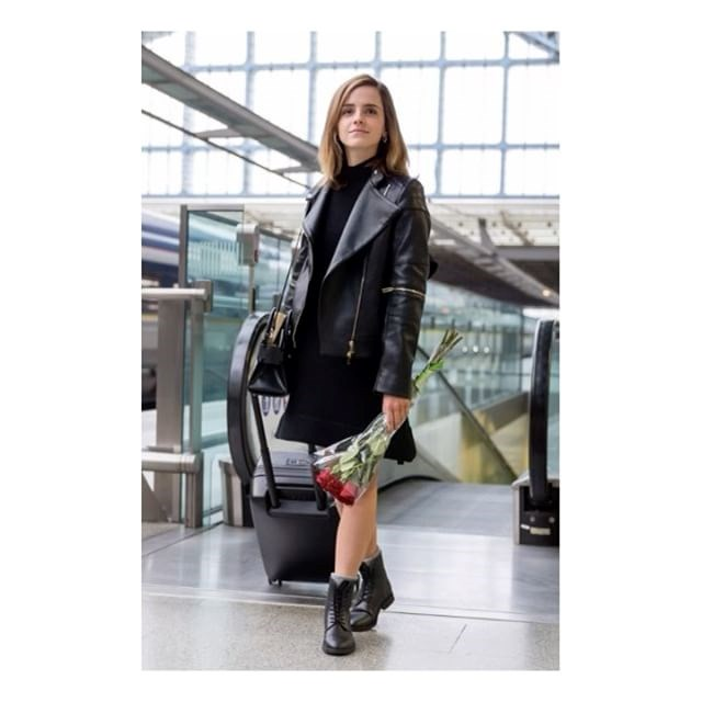 Touching down in London, Emma went from a full Stella McCartney look, which included a turtle-neck dress and a faux leather jacket. And, of course, she added a cheeky <em>Beauty and the Beast</em> twist, by carrying along a bunch of red roses—the film's emblem.
