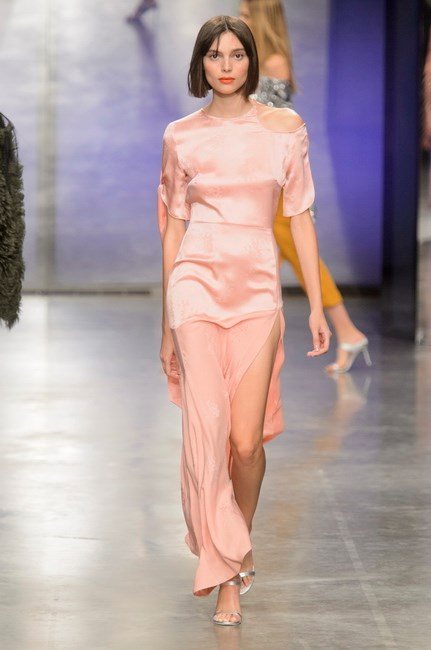 <p> <strong>Topshop Unique</strong><p> <p> The Topshop team had optimism on their minds when creating the latest collection, and the world was definitely, if only momentarily, looking like a better place by the time Aussie model Charlee Fraser emerged in this long pink satin gown. See now, buy now, or regret for events to come.