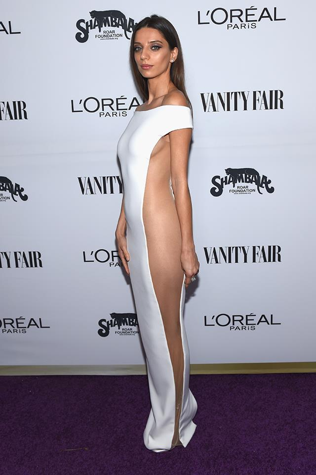 Westworld actress Angela Sarafyan sported this Celia Kritharioti white column dress at a Vanity Fair party in L.A.—which she wore completely sans-underwear.