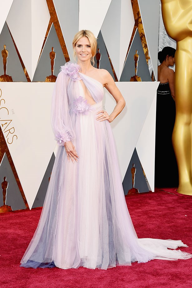 <strong>Heidi Klum, 2016</strong><br></br> While the reception of Heidi Klum's 2016 Marchesa gown was less than enthusiastic, sporting a techni-colour lavender number adorned with multiple fabric flowers was daring from the outset.
