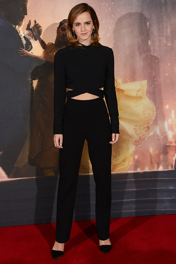 Emma looked stunning in a black top and high-waisted pants at the photocall for <em>Beauty and the Beast</em> in London.