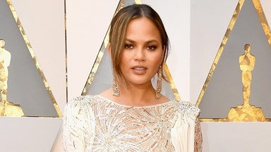 Chrissy Teigen's White-And-Gold Oscars Dress Is So Pretty