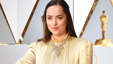 Dakota Johnson's Gucci Dress At The Oscars Is Dividing Fans