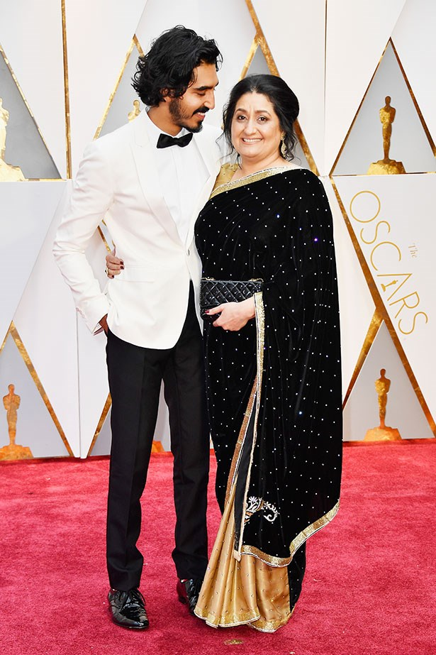 Dev Patel looks lovingly at his mother, Anita.