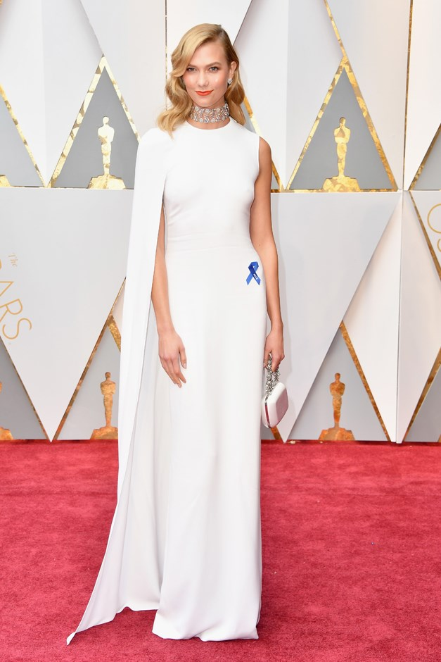 Karlie Kloss pinned a blue American Civil Liberties Union pin to her white Stella McCartney.