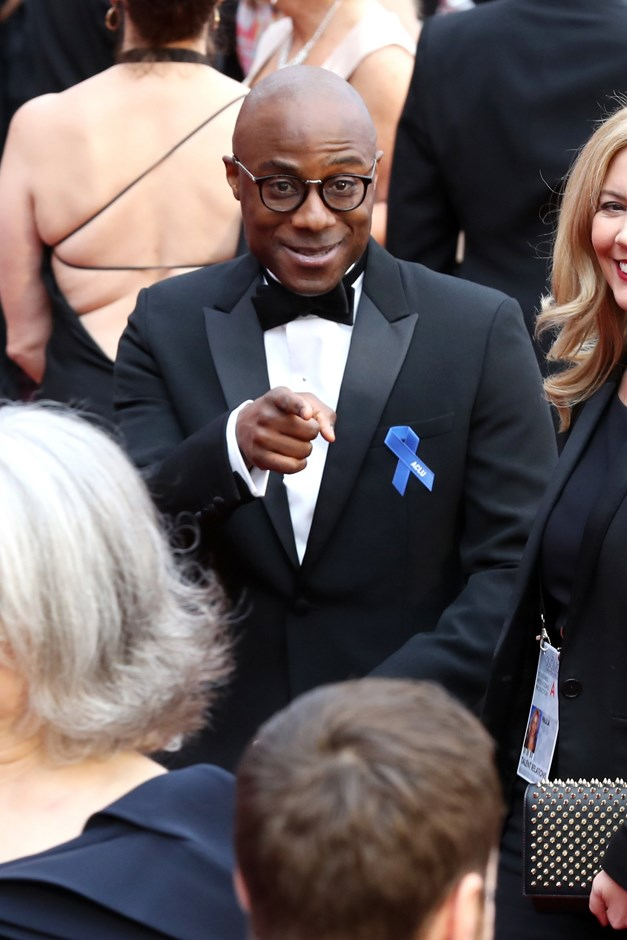 Barry Jenkins, director of <em>Moonlight</em>, pinned one to his tux.