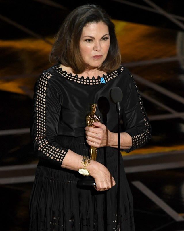 """While accepting her Oscar for Best Costume Design, Colleen Atwood wore a <a href=""""http://www.glaad.org/"""">GLAAD</a> '&' pin."""