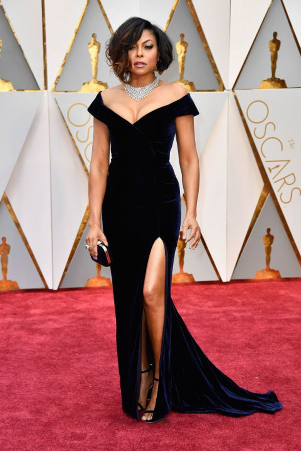 <strong>Taraji P. Henson in Alberta Ferretti</strong> <br><br> Henson may have some recalling Angelina Jolie's famous leg-out Oscar look, but she's owning it. Her custom midnight blue Alberta Ferretti gown had an off-the-shoulder neckline that showed off mega Nirav Modi diamonds; the Angelina leg slit revealed classy ankle-strap heels.