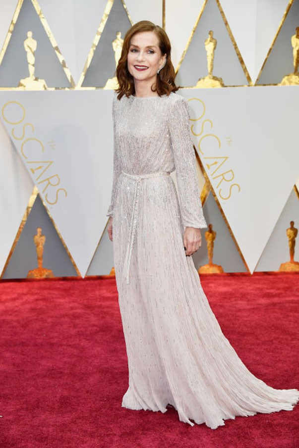 <strong>Isabelle Huppert in Armani Privé</strong> <Br><br> Because of course the French woman at the Oscars would have impeccable style. Huppert's super sparkly Armani Privé gown pooled at the wrist and floor, yet didn't feel like too much fabric thanks to a skinny (and gem-encrusted) belt at the natural waist.