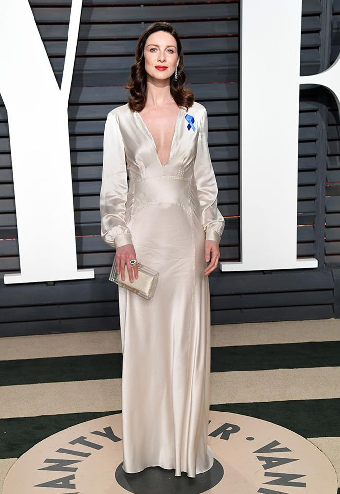 <em>Outlander</em> star Caitriona Balfe's pin stood out against her cream gown.