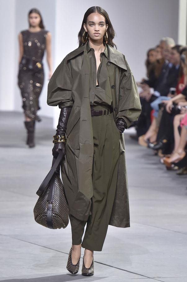 <strong>TAURUS</strong> <br><br> Steadfast and practical, Taurus will naturally gravitate toward khaki, one of spring's favourite fabrics, seen here at Michael Kors. But no pleated slacks for you—instead, branch out with a billowy trench-inspired top *and* pants that could fit you and two friends. And don't forget your mega earrings.