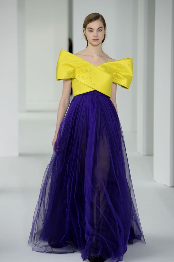 <strong>GEMINI</strong> <br><br> You'll have your pick of poppy colours this year (your fave), but may we recommend a yellow? Or a marigold, maybe? Delpozo's got the right idea pairing a crossover bodice with a complementary violet.