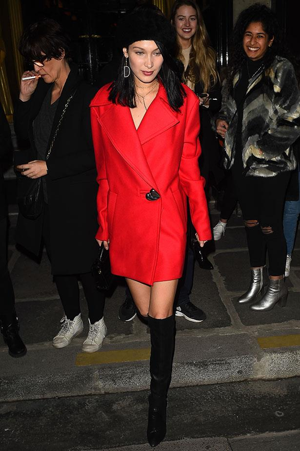 Bella Hadid steps out at Paris Fashion Week donning the country's most iconic fashion piece: the beret, teamed with an '80s-inspired oversized blazer coat.