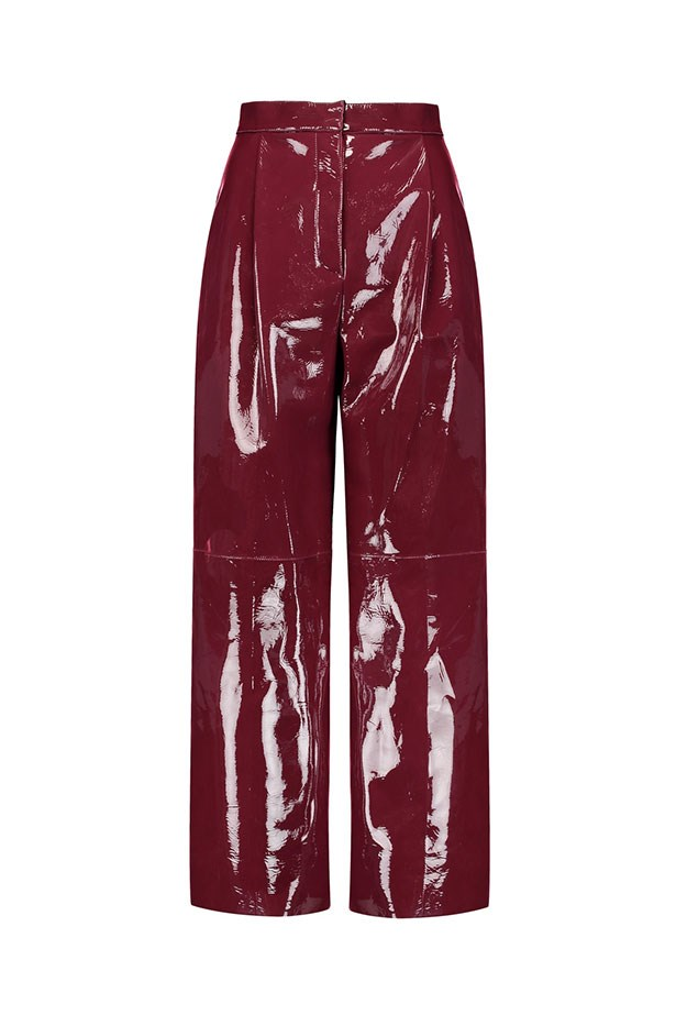 """Pants, $3,865 (approx.), Valentino at <a href=""""https://www.theoutnet.com/en-AU/Shop/Product/Valentino/Glossed-leather-wide-leg-pants/804629"""">The Outnet</a>."""