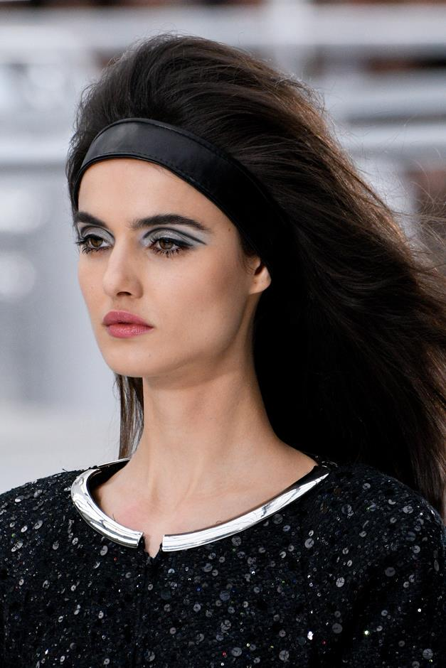 <p><strong>THE BEAUTY M.O.</strong> <p>Chanel showed a '60s cut-crease, styled with a very '90s thick headband.