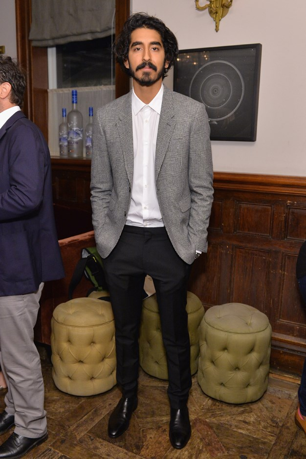 In a grey blazer and crisp white shirt-combo at the <em>Lion</em> TIFF party.