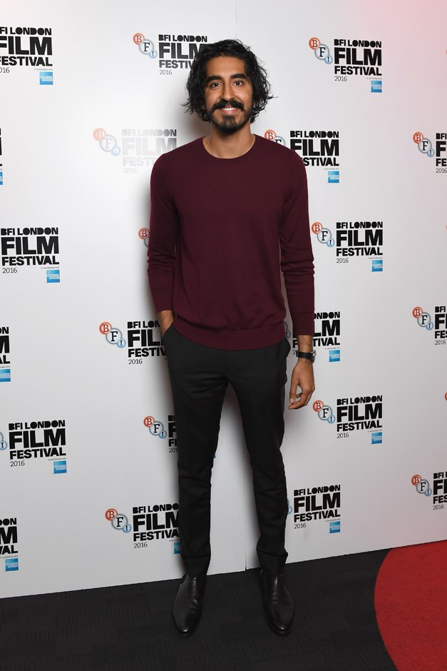 In a burgundy sweater and suit pants at Screen Talk.