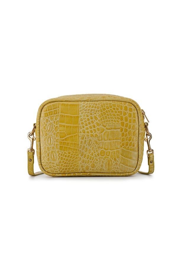 "Bag by Deadly Ponies, approx. $489 at <a href=""https://deadlyponies.com/shop/mr-teddy-crocotile/yellow/"">Deadly Ponies</a>"