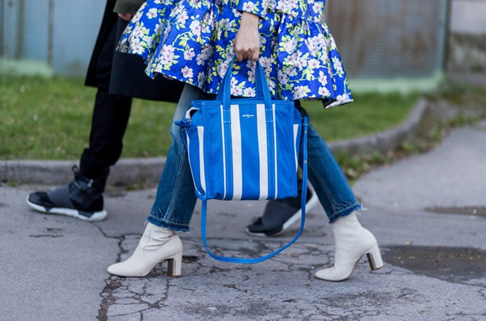 The style set have showed-off the must-have bag of the season at fashion month, Balenciaga's Bazar striped leather-textured tote.
