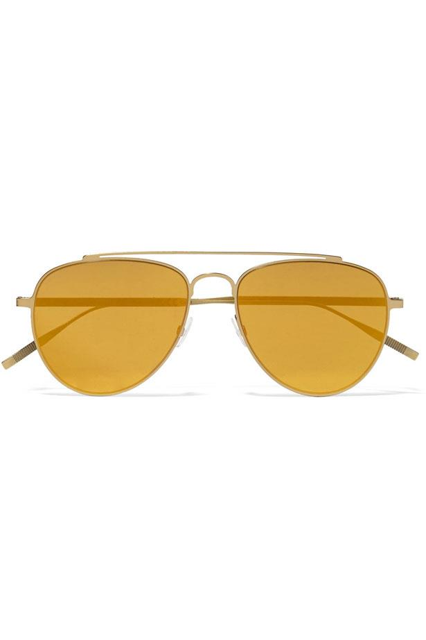"Sunglasses, $296, Tomas Maier from <a href=""https://www.net-a-porter.com/au/en/product/799921/tomas_maier/aviator-style-gold-tone-mirrored-sunglasses"">Net-A-Porter</a>."