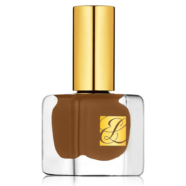 """ESTEE LAUDER NAIL LACQUER IN NOVEAU RICHE <br><br> This delicious chocolate shade provides light to dark olive skin with a healthy radiance and the gilt-topped bottle looks seriously pretty on any dressing table. <br><br> <a href=""""https://www.esteelauder.com.au/product/631/13562/product-catalog/makeup/pure-color/nail-lacquer"""">Estée Lauder, $38</a>"""