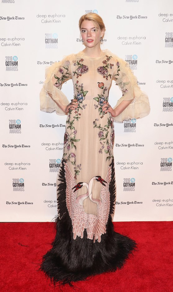 In a nude and feathered Gucci gown.