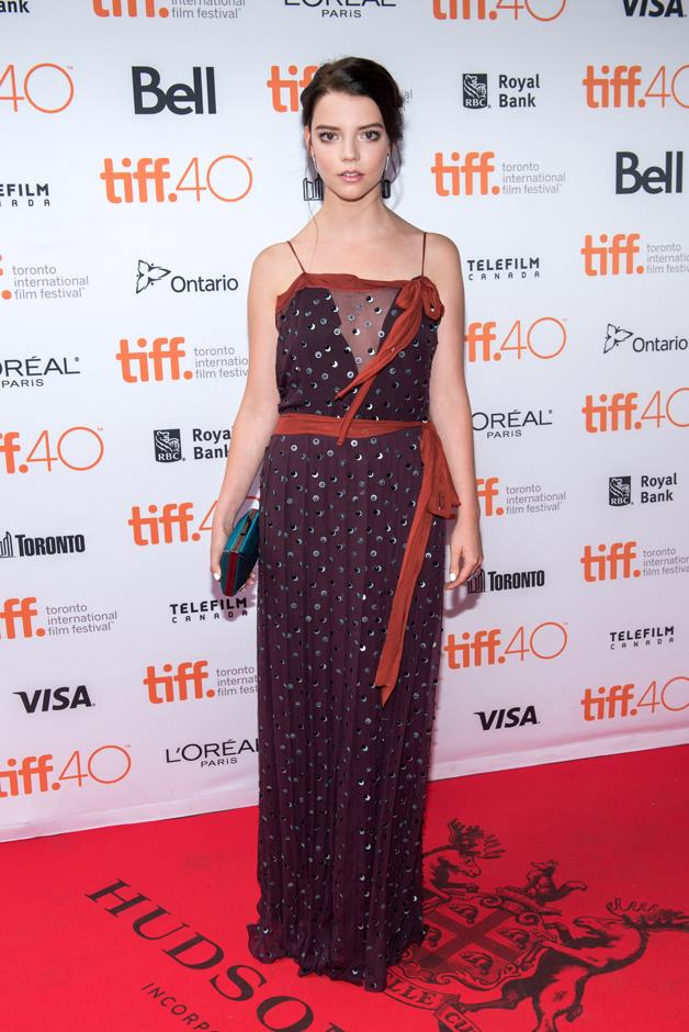 Anya wore this Prada gown with contrasting sashes to another premiere of <em>The Witch.</em>