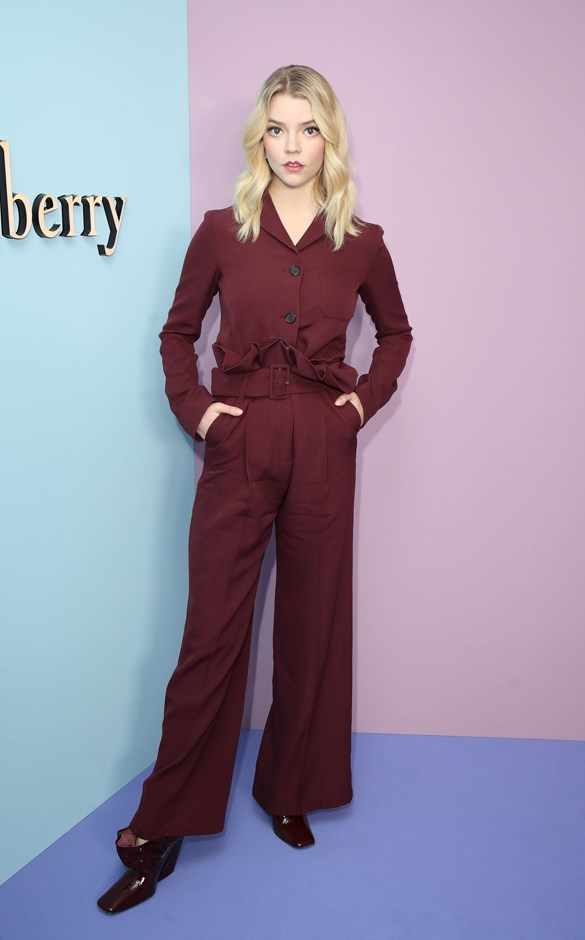 Wearing an all-burgundy Mulberry look.