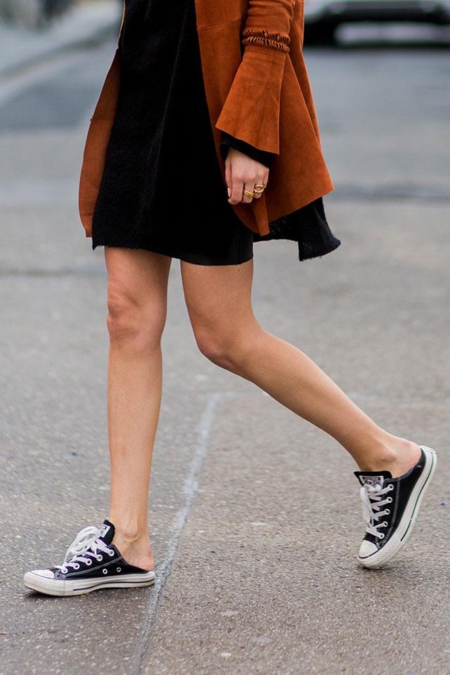 <strong>3. Slip 'Em On </strong> <br><br> There was a time when sliding your feet into your shoes and walking out the door was a sign you're running desperately late. But if the latest street style is anything to go off, times are changing. No more messing around with laces for you.