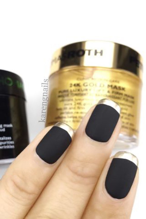 "<strong>Black and Gold.</strong> <p><p> For this look, start with a matte black nail. Add a metallic gold lacquer to your tips for a glam but minimal design. <p><p> Design by <a href=""https://www.instagram.com/p/BHLXPgTg3Pv/"">@karengnails</a>"
