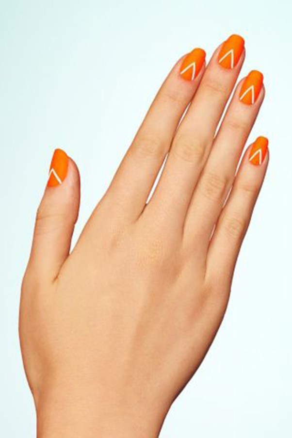 "<strong>Matte Neon.</strong> <p><p> Start with a neon orange base and then add an inverted V to each nail. Once dry, set the look with a matte topcoat. <p><p> Design by <a href=""https://www.instagram.com/p/BGqMw9DmsM4/"">@paintboxnails</a>"
