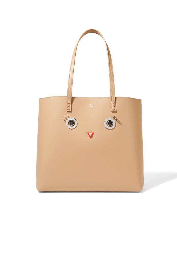 "Bag, $2,400, Fendi at <a href=""https://www.net-a-porter.com/au/en/product/774985/fendi/embellished-leather-tote"">Net-A-Porter</a>"