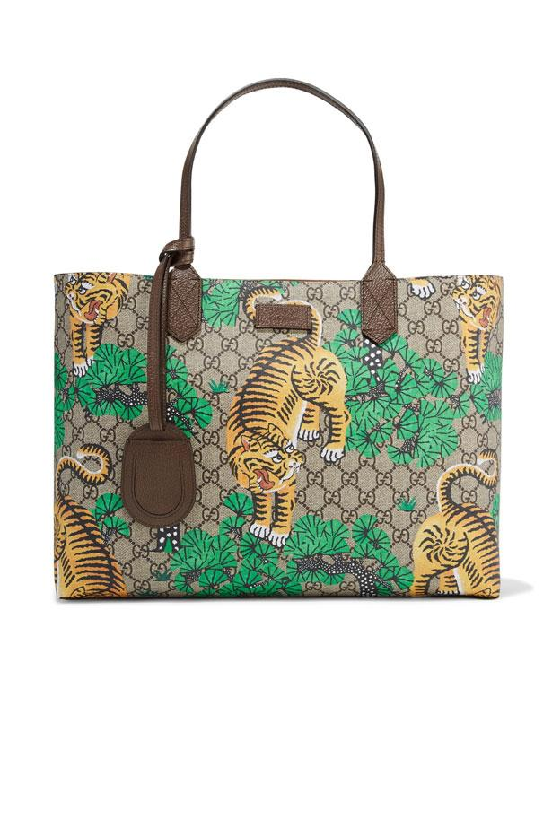 "Bag, $1,400, Gucci at <a href=""https://www.net-a-porter.com/au/en/product/820469/gucci/leather-trimmed-printed-coated-canvas-tote"">Net-A-Porter</a>"
