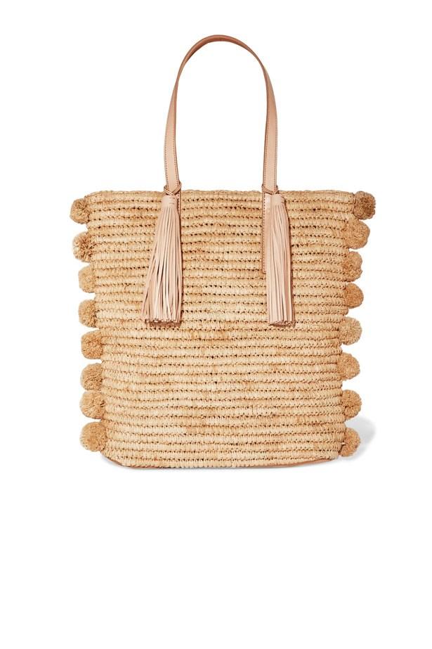 "Bag, $421, Loeffler Randall at <a href=""https://www.net-a-porter.com/au/en/product/849190/loeffler_randall/cruise-pompom-embellished-leather-trimmed-woven-raffia-tote"">Net-A-Porter</a>"