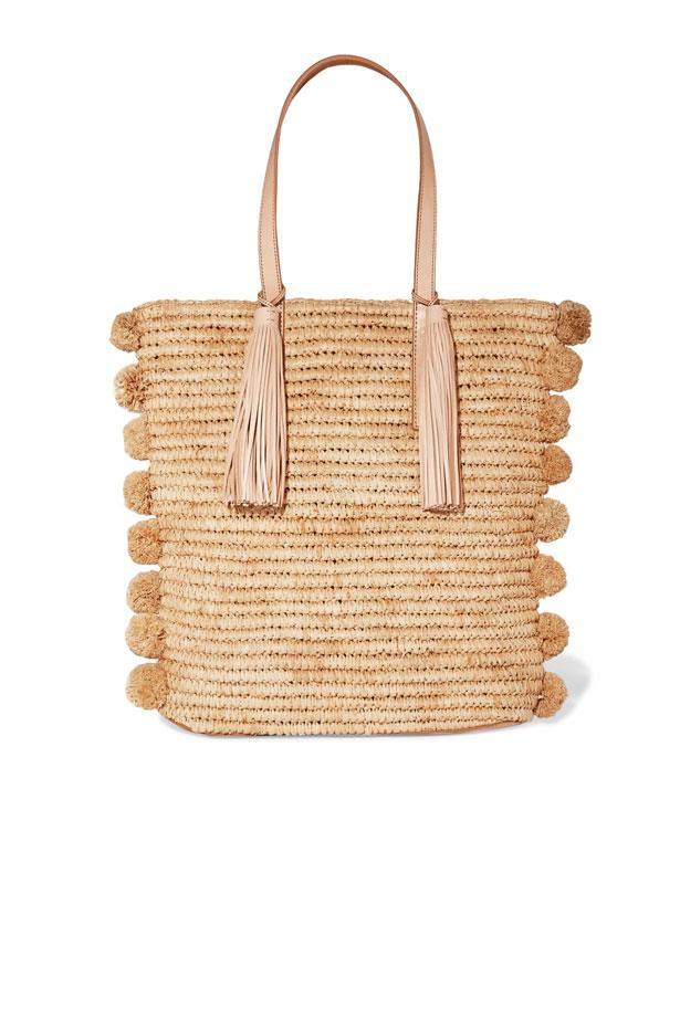 "Bag, $421, Loeffler Randall at <a href=""https://www.net-a-porter.com/au/en/product/849190/loeffler_randall/cruise-pompom-embellished-leather-trimmed-woven-raffia-tote"">Net-A-Porter</a>"