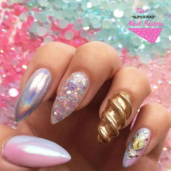 "<strong>3d Unicorn Nails</strong> <br><br> How does one hold down a 9-5 desk job with 3d unicorn nails? Do they come with voice recognition software? Because we can't imagine the owner of this manicure would be doing much typing. <br><br> Image: <a href=""https://www.instagram.com/superradnailsisters/"">@superradnailsisters</a>"