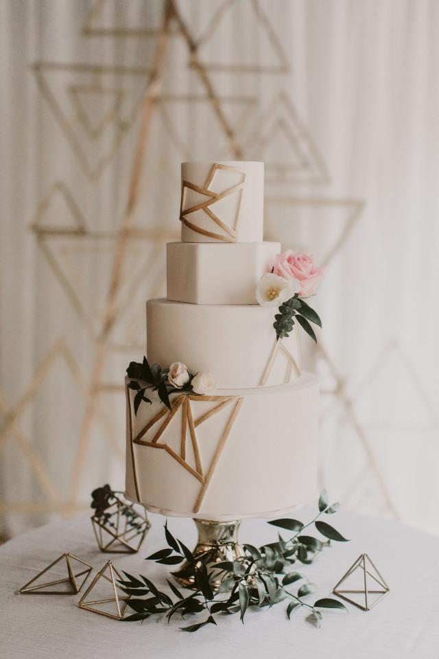 "<p><strong>GEOMETRIC</strong><p> A design that often features on the pages of lifestyle mags, geometric-style cakes are back for another year. Perfect for the couple who loves clean-cut, sleek and modern designs. Go on, be a shape-shifter.<p> Image credit: <a href=""https://elizabethscakeemporium.com/"">Elizabeth's Cake Emporium</a>"