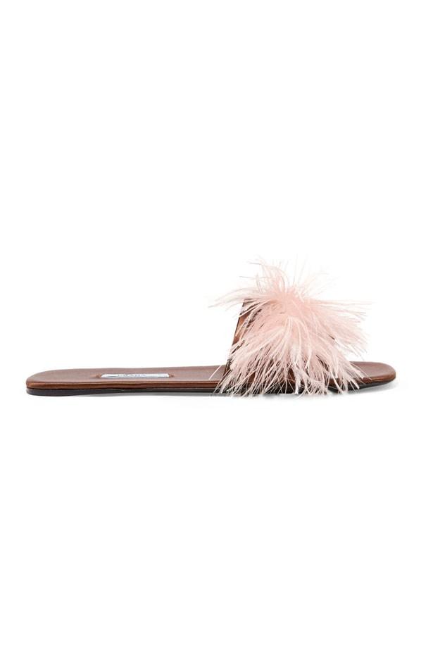 "Flats, $990, Prada at <a href=""https://www.net-a-porter.com/au/en/product/860762/prada/feather-embellished-satin-slides"">Net-A-Porter</a>"